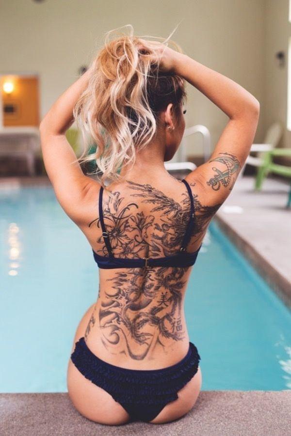black womens back piece tattoo