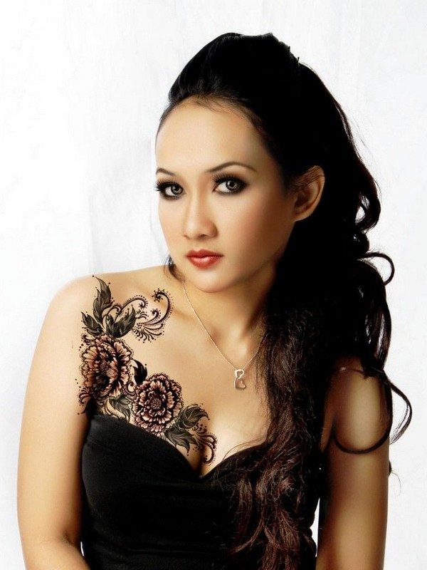 black flowers tattoo designs for women chest