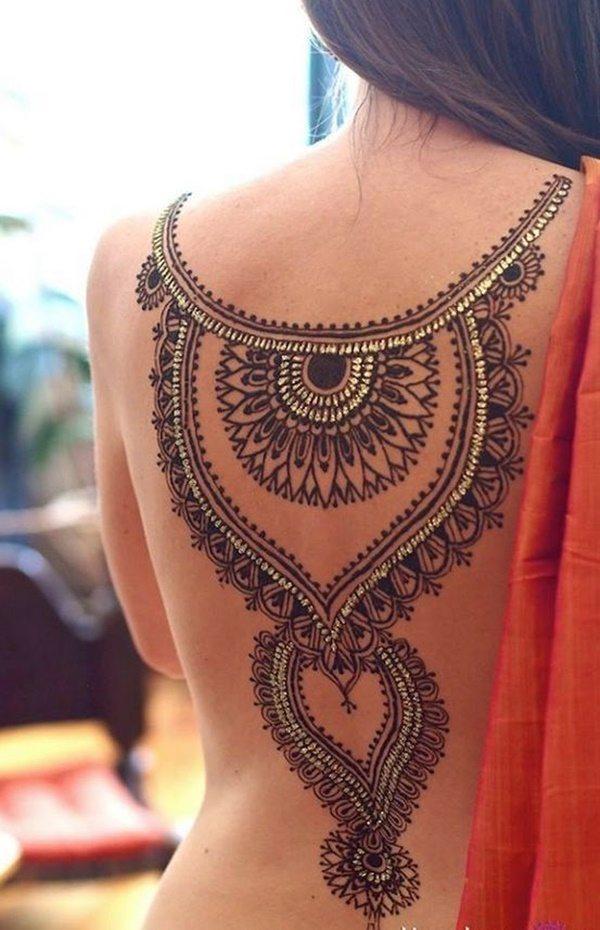 mandala lower back tattoos for women