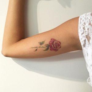 red rose female lower arm sleeve tattoos