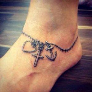 cross tattoo design for womens feet design