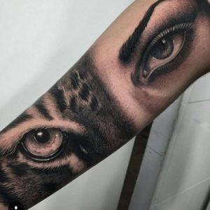 lower arm tiger eye tattoos for females pictures