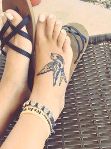 Small womens bird foot tattoo ideas