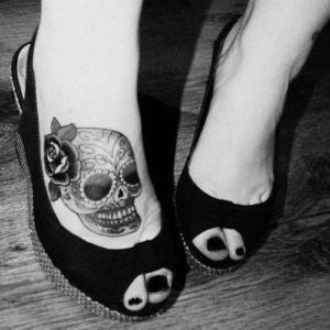 black skull tattoo design in feet design images