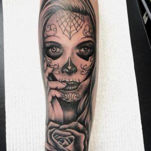 abstract skull flower on women arm design