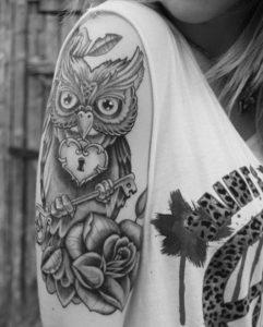 black rose shoulder arm tattoos for women