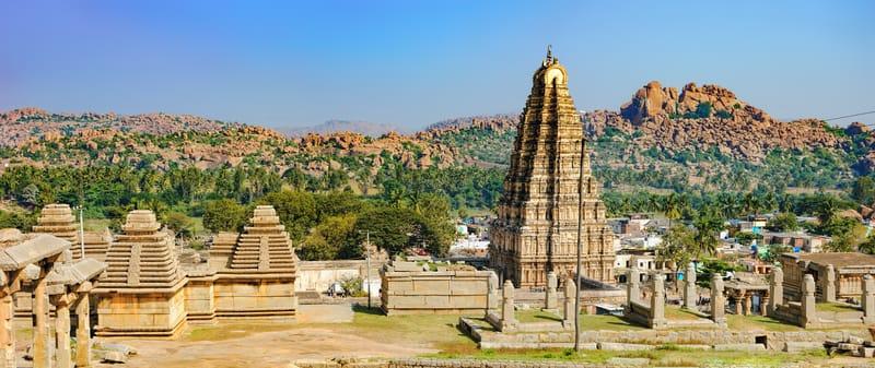Hampi is a temple town located amidst the ruins of Vijayanagara, Karnataka