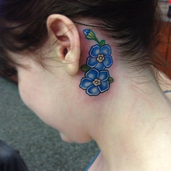 flower tiny tattoo behind ear