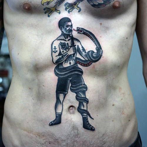 man fighting snake tattoo on stomach