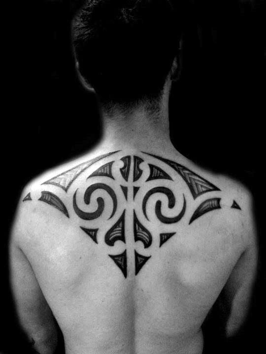 mandala tattoo design on the back for men