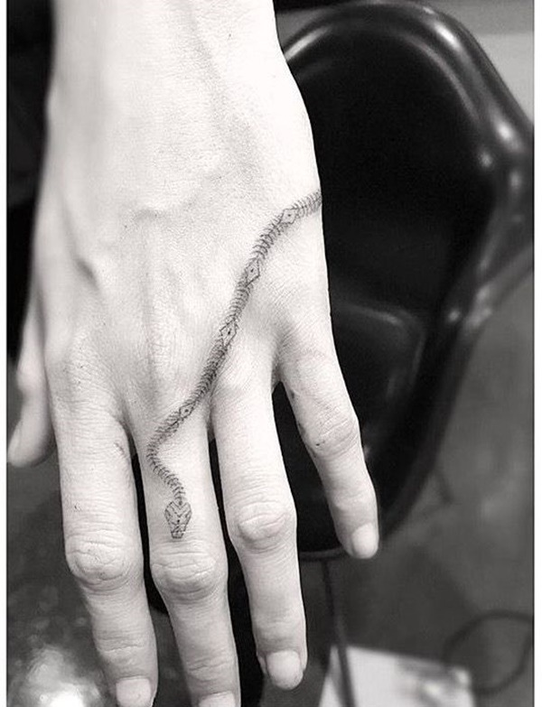 small snake skin tattoo on hand for women