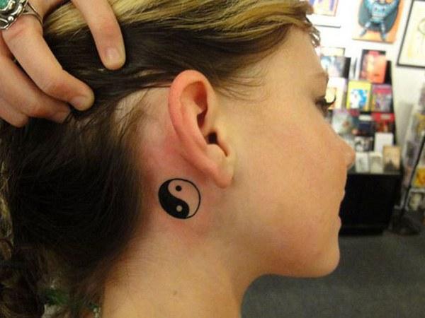 behind ear yin yang symbol tattoo