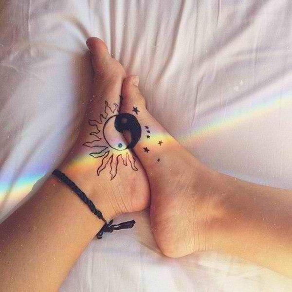 sun and moon yin yang tattoo on foot