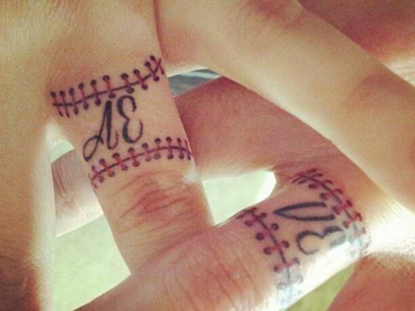 initials on ring finger tattoo design ideas
