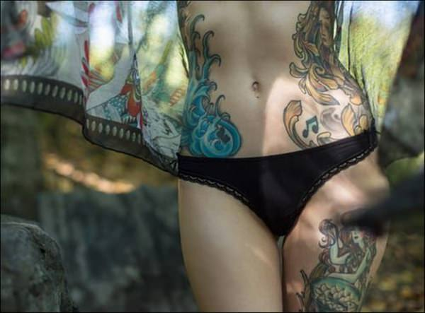 flower color stomach cover up tattoos