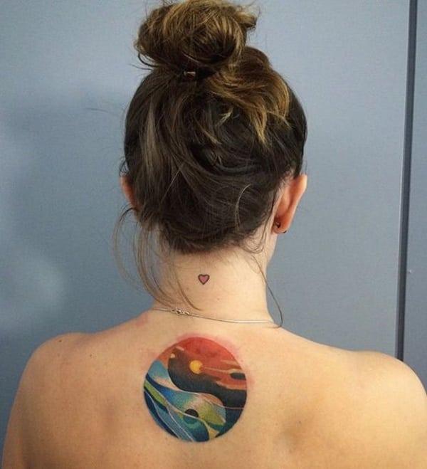 back watercolor yin yang tattoo for girls