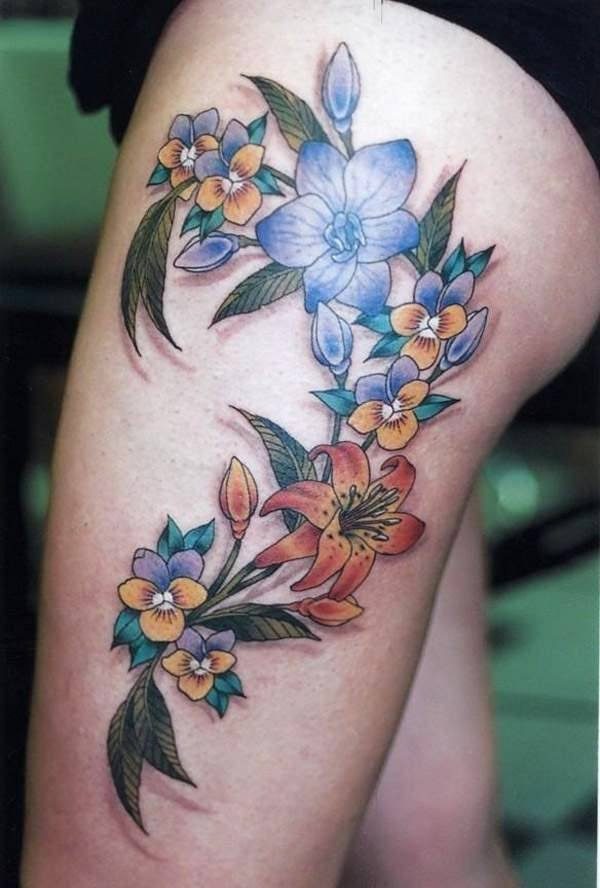 colors flower thigh tattoo ideas pictures