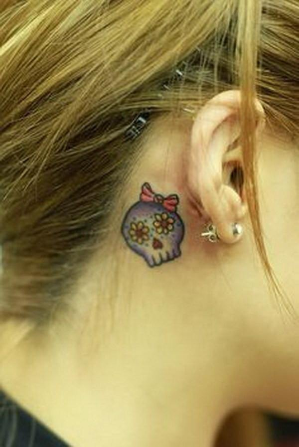 skull small tattoos behind your ear