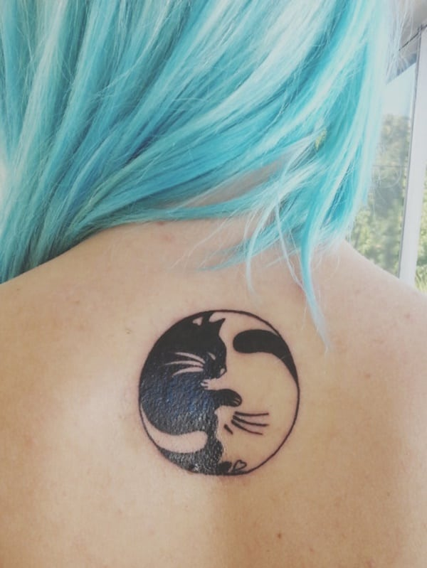yin and yang sun and moon tattoo on back for female