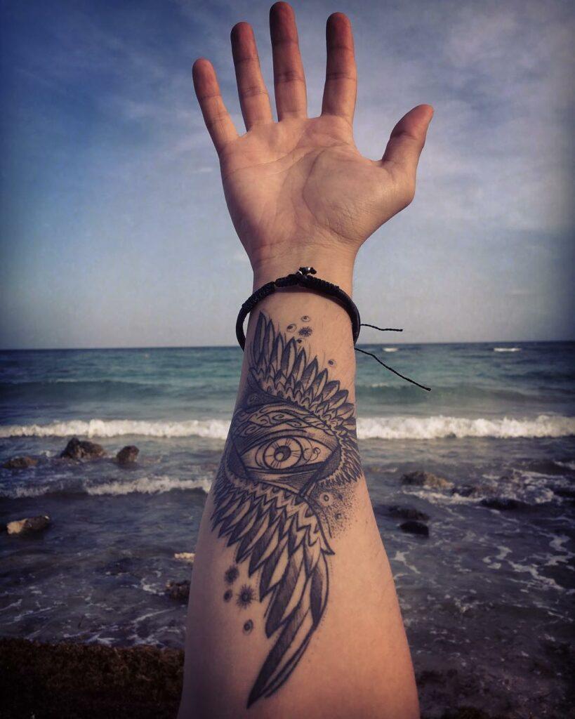 arm minimalist wing tattoo