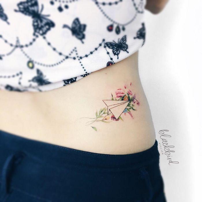 travel design tattoo on back for women