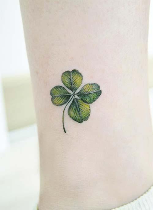 women ankle july flower tattoo