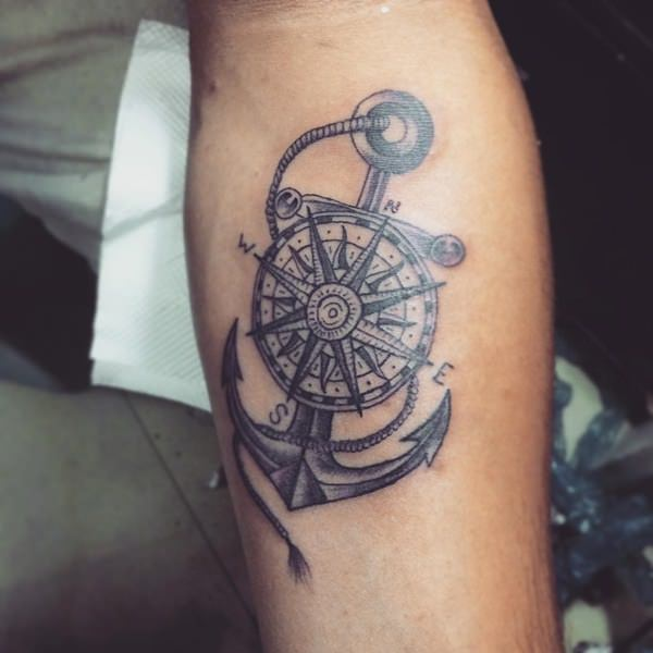 guys arm compass and anchor tattoo meaning