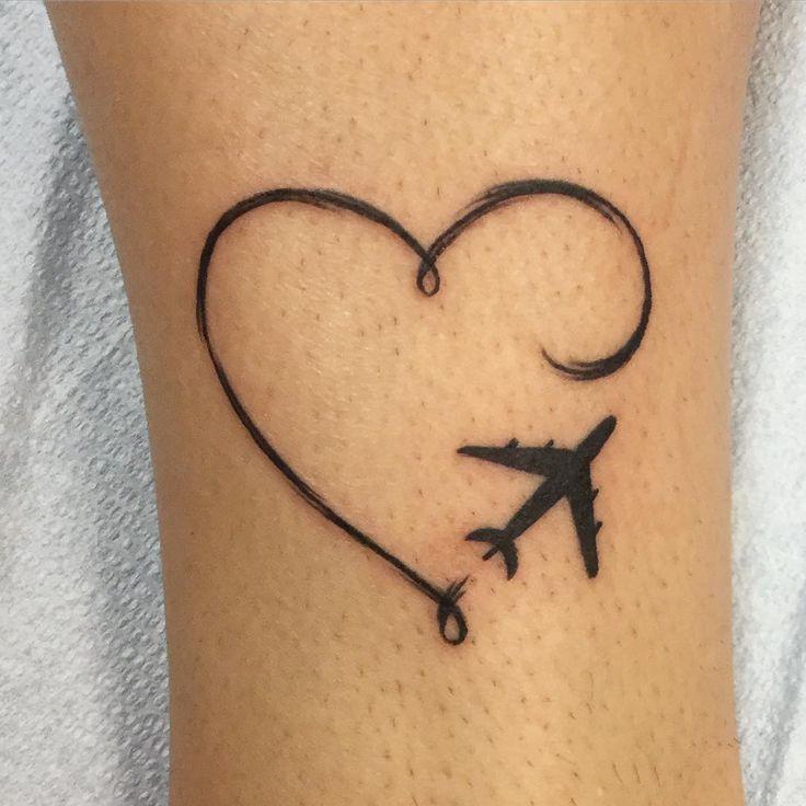 plain travel tattoos for men on arm