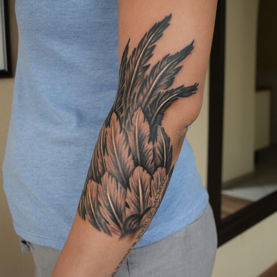 men celtic wings tattoo