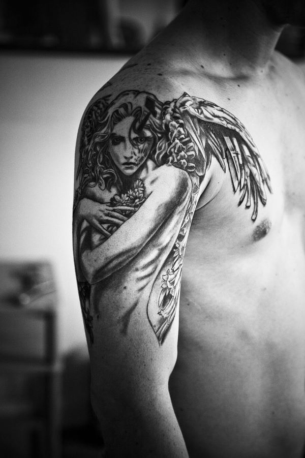 shoulder heart with angel wings meaning