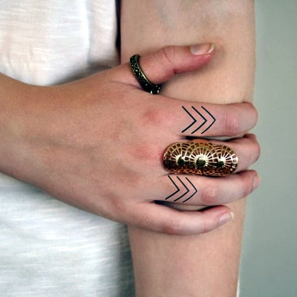 mandala tattoo finger