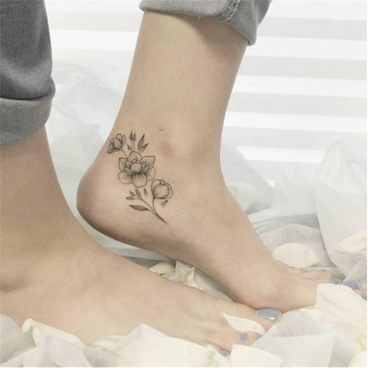 female small flower tattoo designs on leg