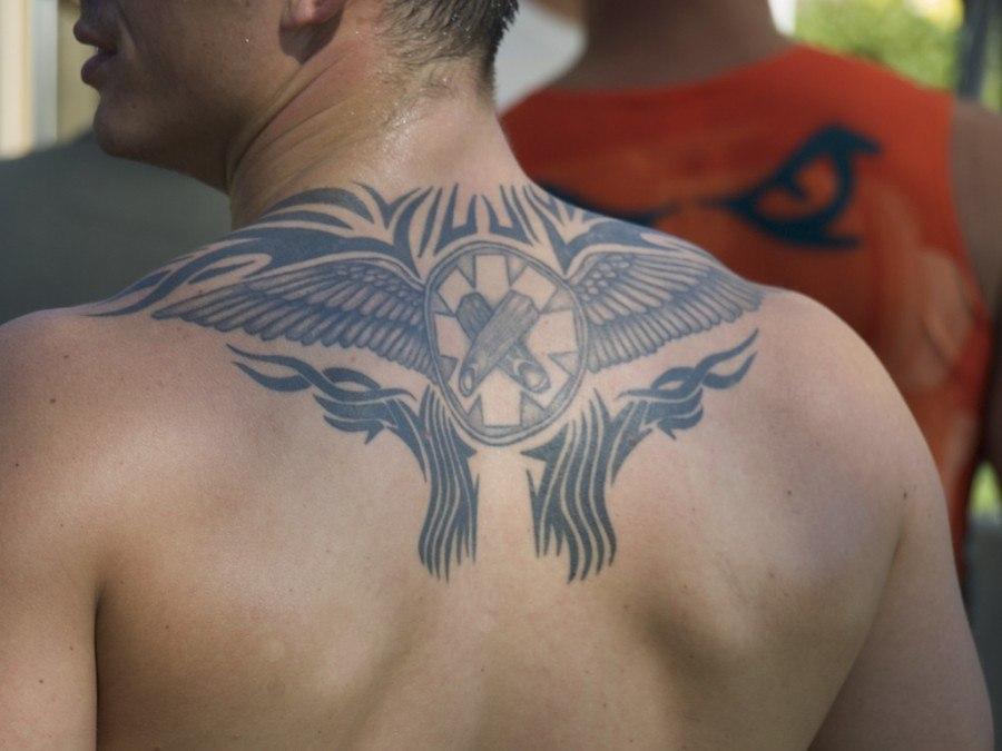 neck tattoos for men wings design