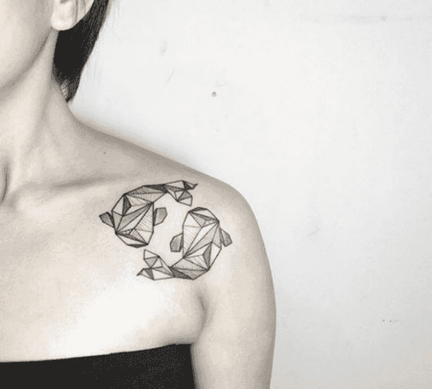 abstract fish tattoo on shoulder