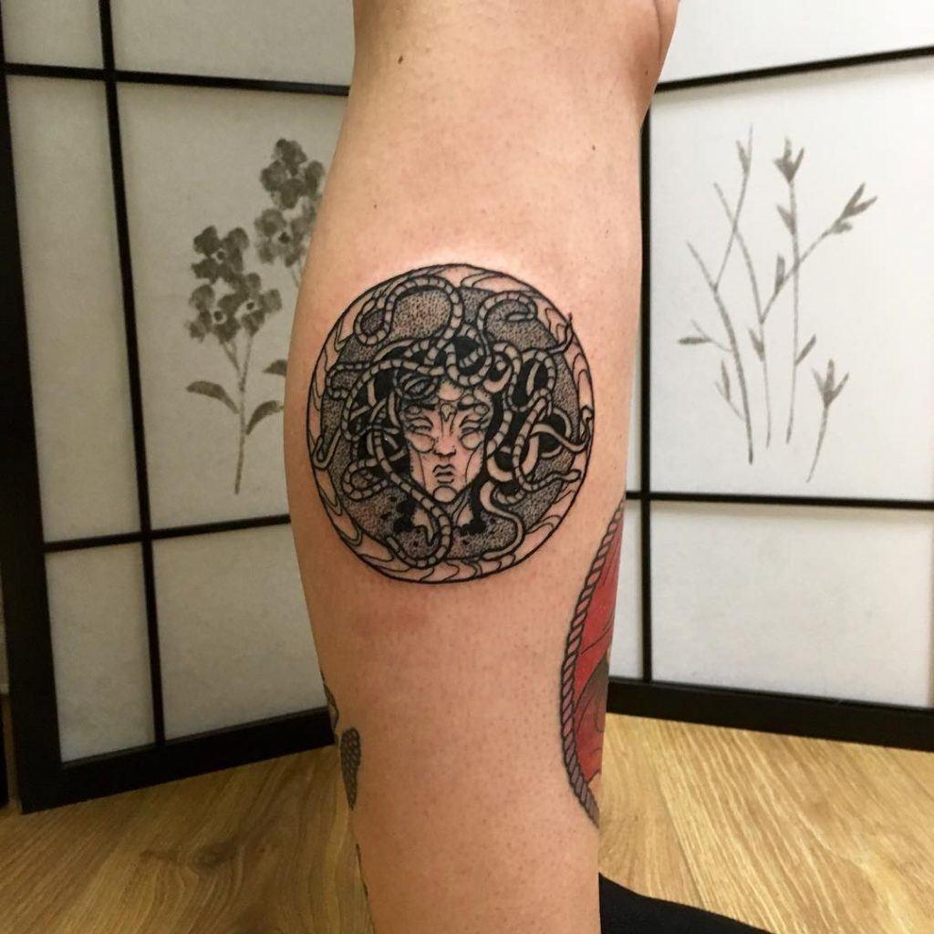 foot small dark medusa tattoo