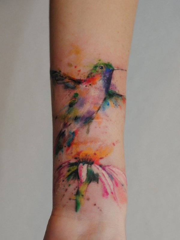 arm Multi coloured bird tattoo design ideas