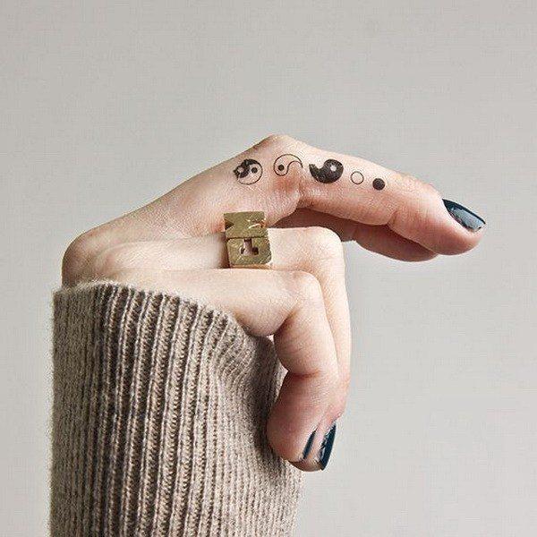 female finger tattoo ideas