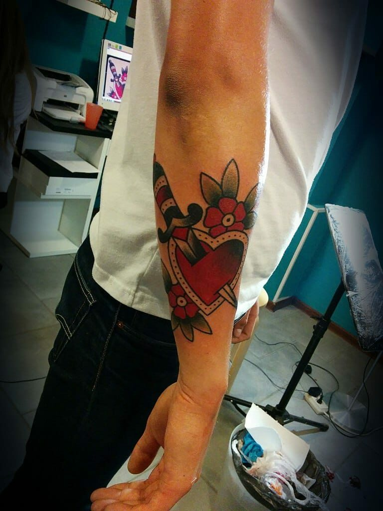 knife through heart tattoo for men images