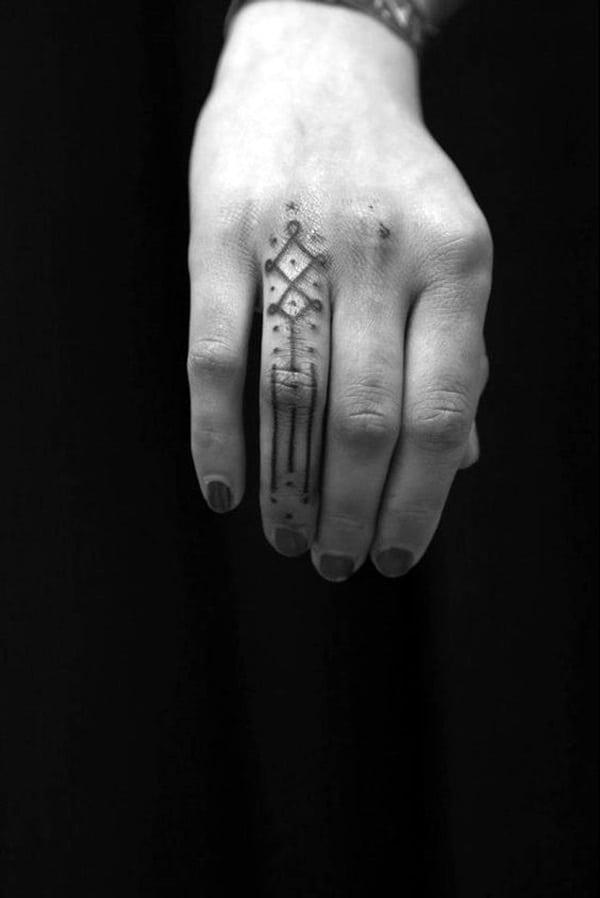 celtic cross finger tattoo