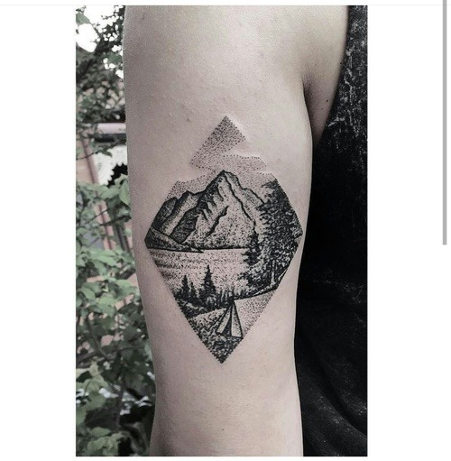 mountain travel tattoo on hand