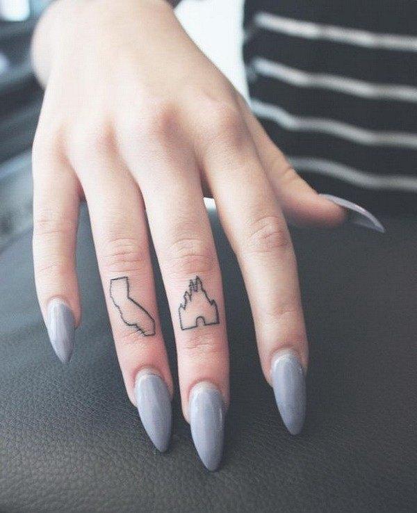 women tattoo on hand finger
