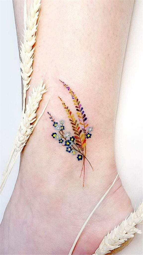 ankle flower drawing tattoo