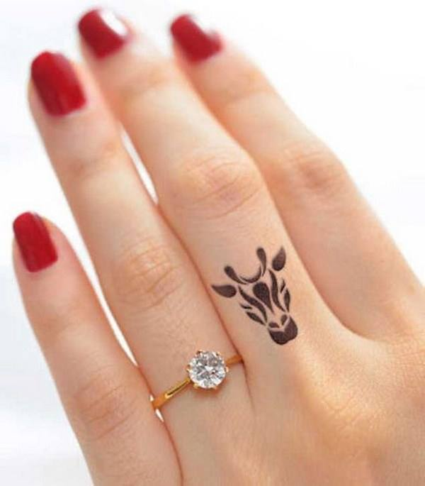 cow finger tattoo designs for ladies