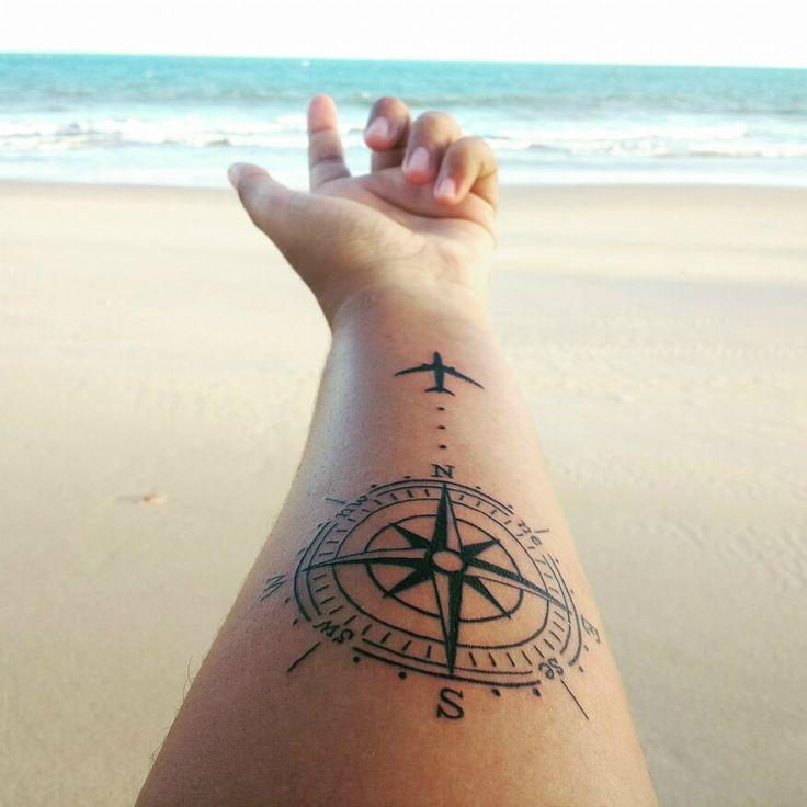 travel compass tattoo with plane design