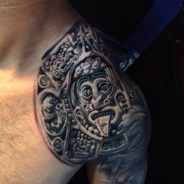 shoulder tribal stone tattoo design for men