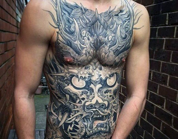 tattoos to cover stretch marks on belly for guys