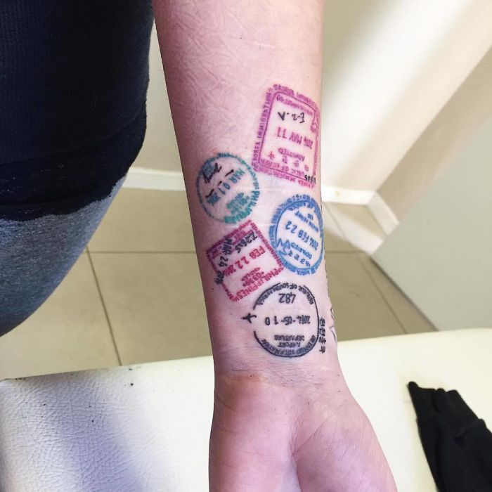 arm travel inspired tattoos