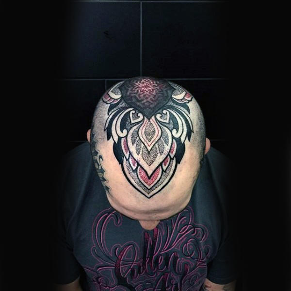 cool bald man with tattoo on head design