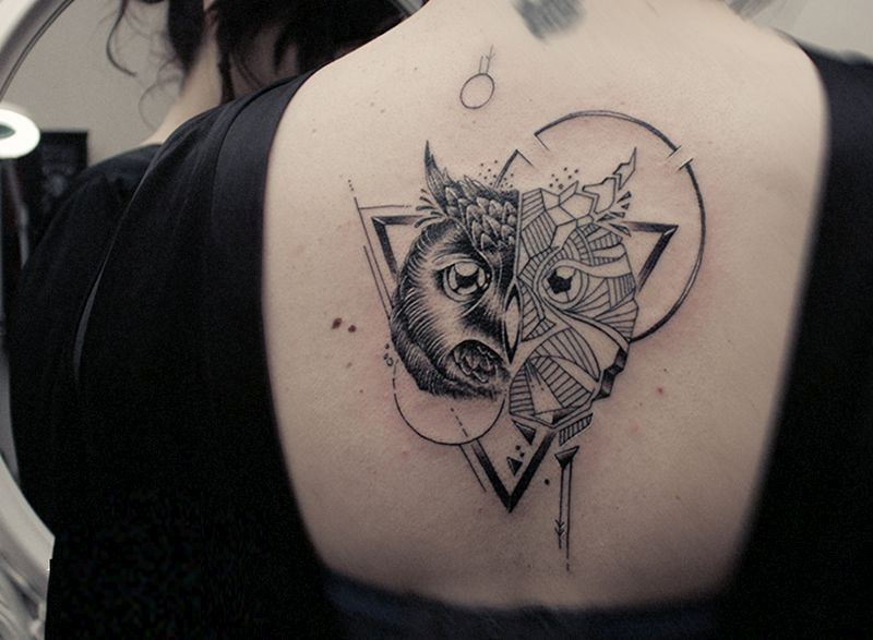 girl with owl tattoo on back