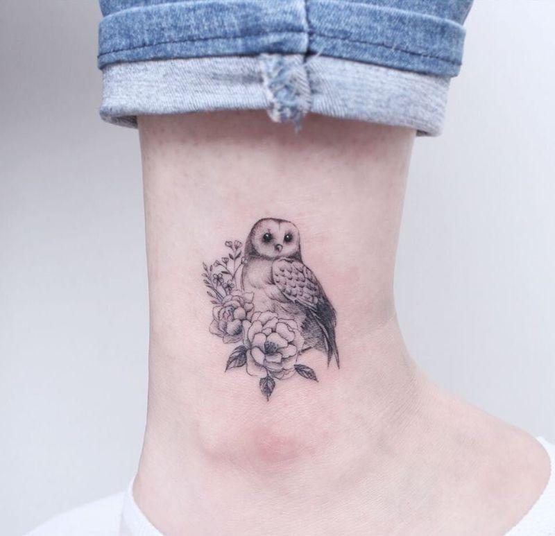 small barn owl tattoo on foot